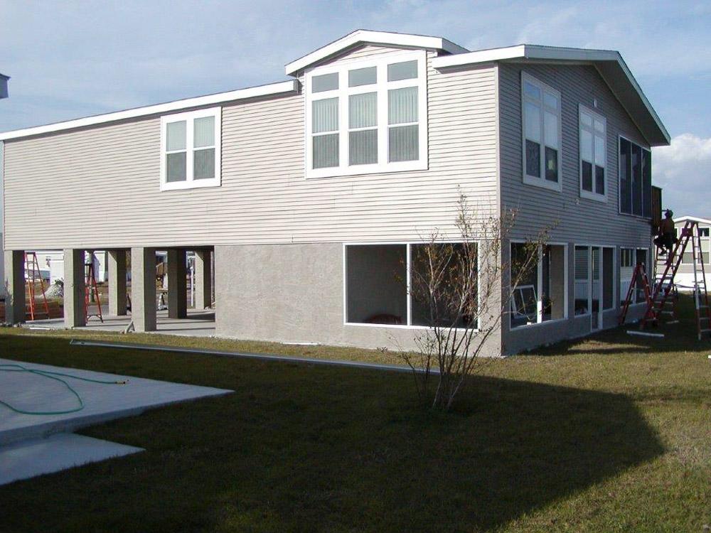 Custom manufactured stilt homes and modular stilt homes for Manufactured home on stilts